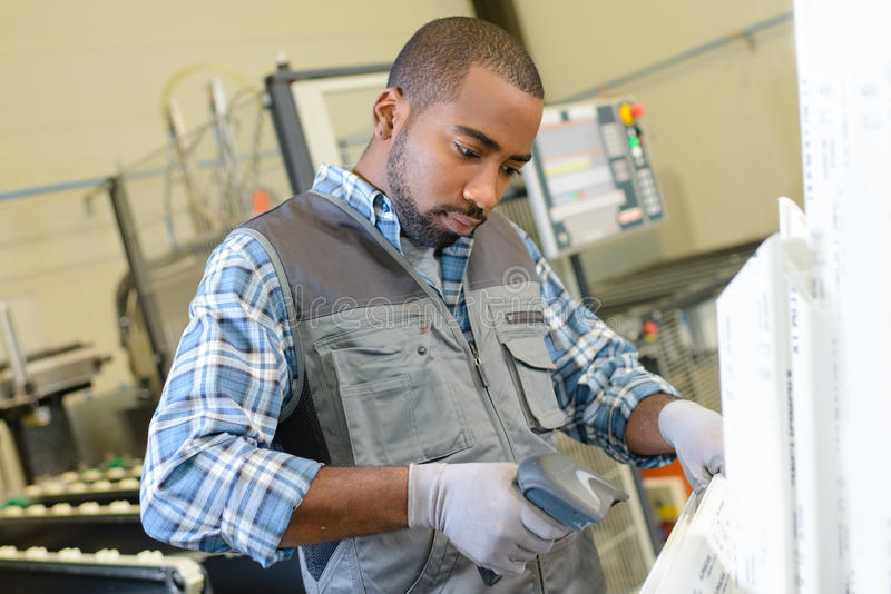Worker using barcode reader royalty free stock images