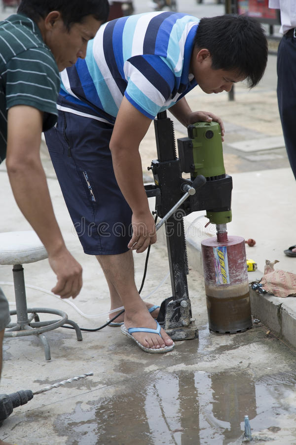 Worker using drill stock photography