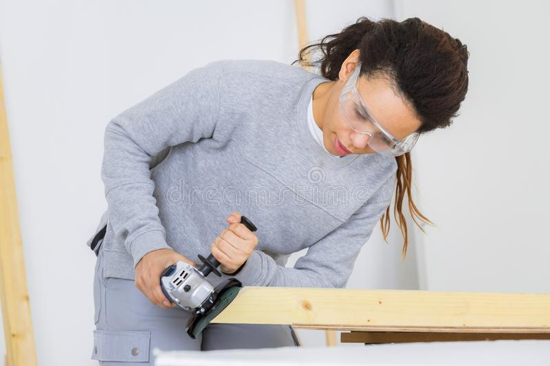 Worker using electrical tool on wood royalty free stock photos