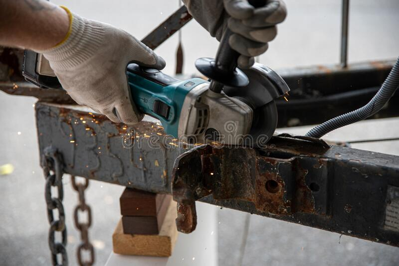 Worker using a metal grinder machine royalty free stock photography