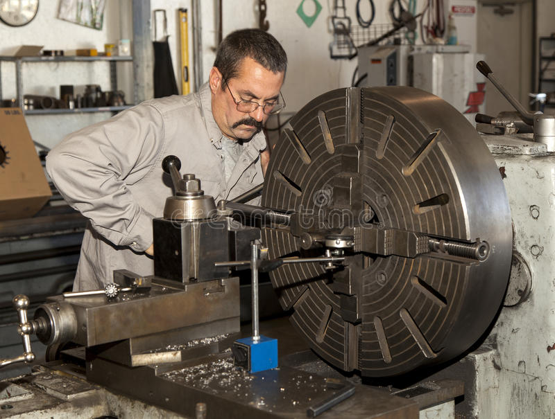 Worker using a Metal Lathe stock photography