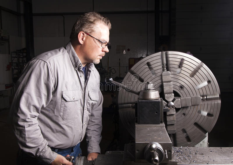 Worker using Metal Lathe stock image