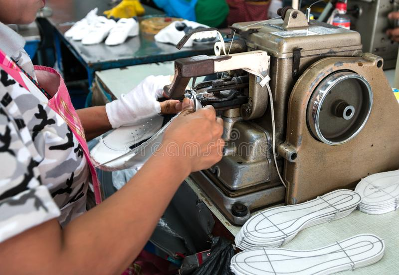 Shoe making process by sewing machine royalty free stock images