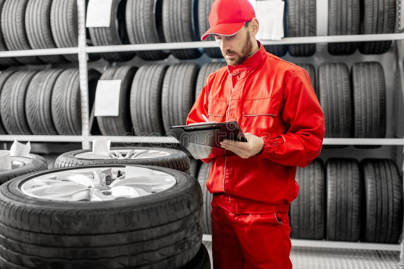 Worker in the warehouse with car tires royalty free stock photography