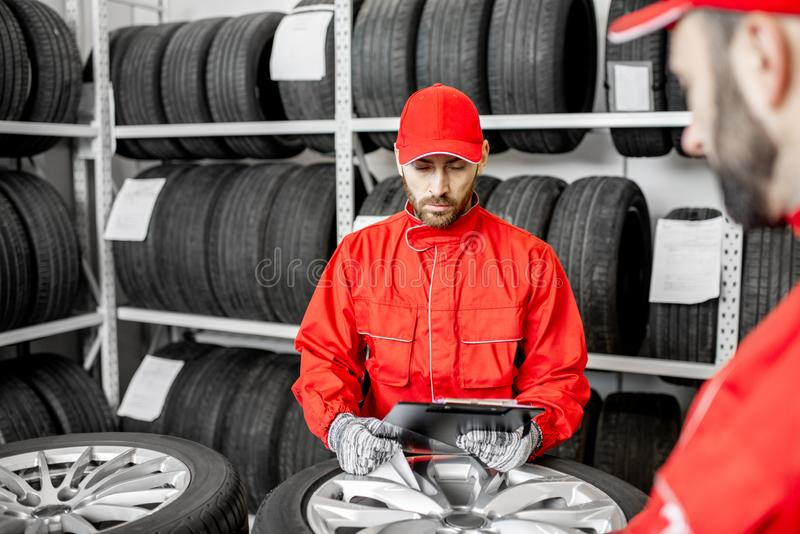 Worker in the warehouse with car tires royalty free stock images