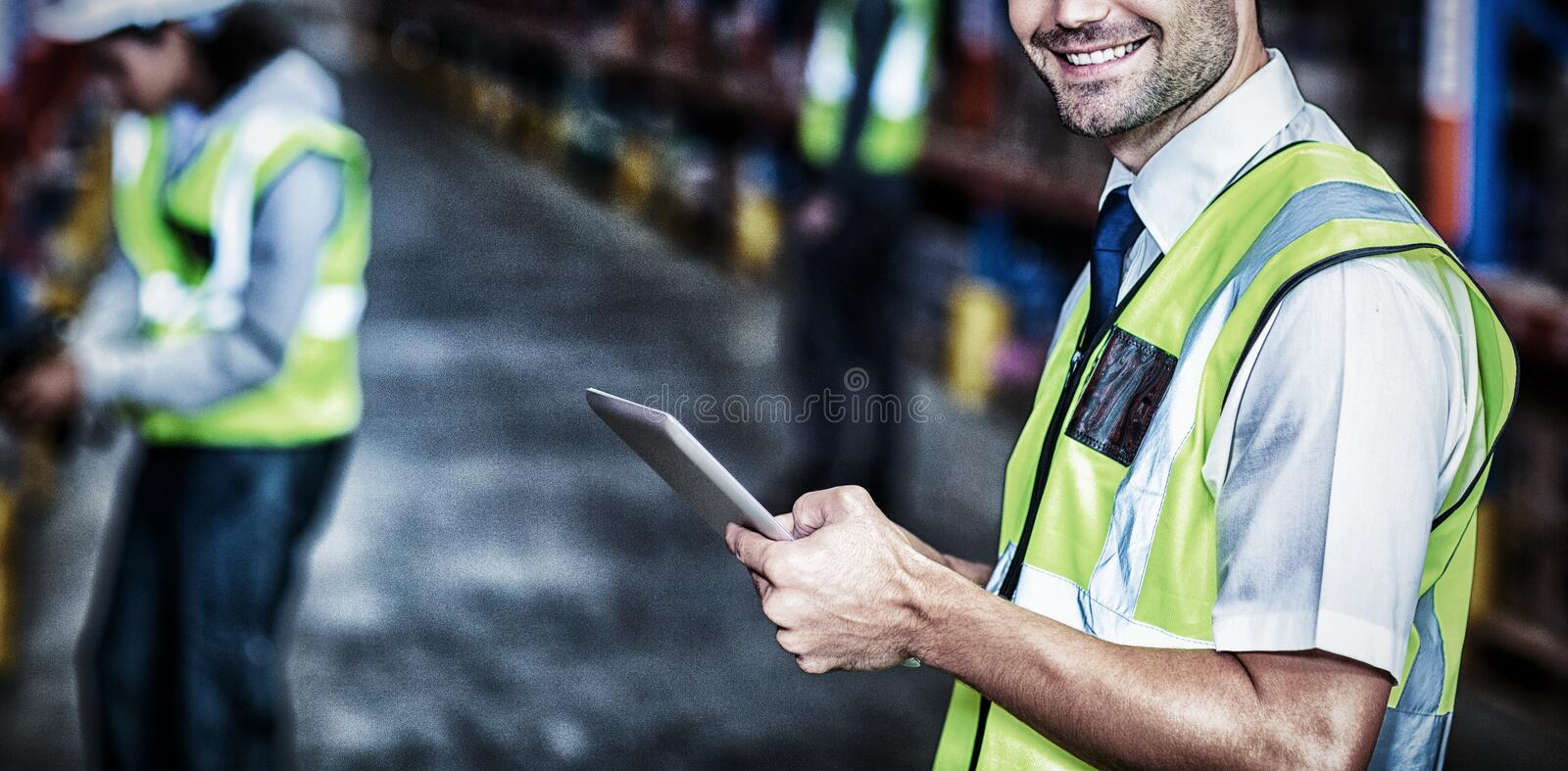 Worker in warehouse looking at camera royalty free stock photo