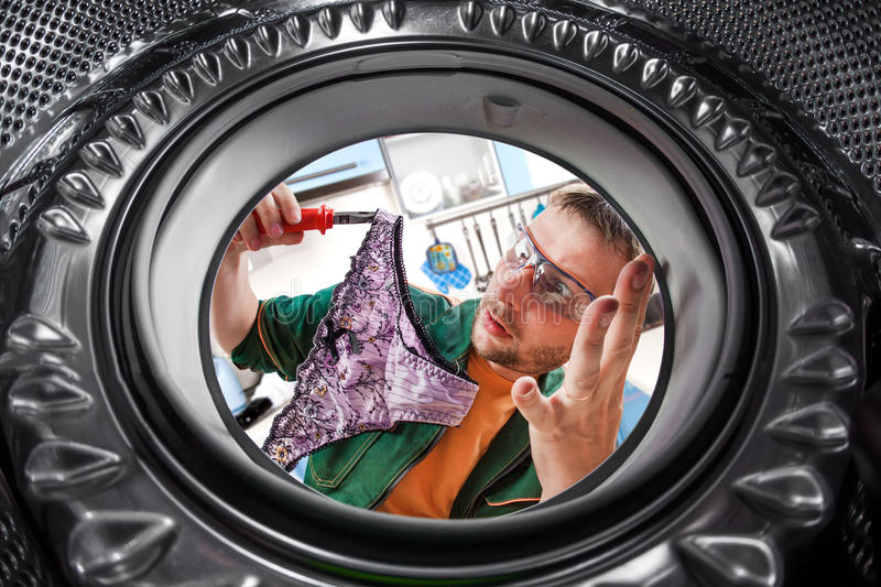 Download Worker And A Washing Machine Stock Photo - Image: 26181764