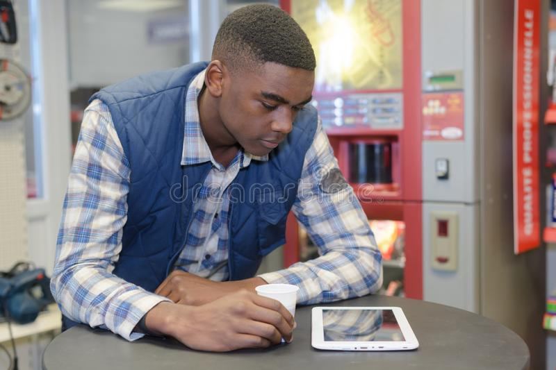 Worker watching something on tablet during breaks stock photo
