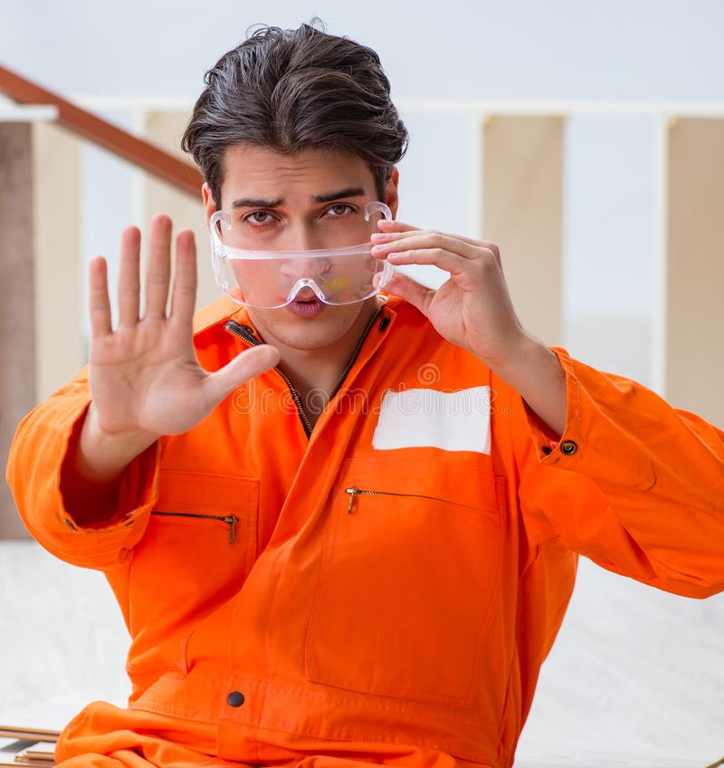 Worker wearing protective goggles at construction site stock photos