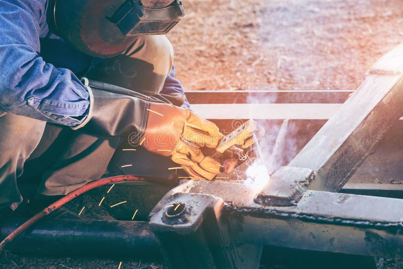 Worker welder working welding steel in industry with safety mask safety gloves and safety equipment. Wolker welding concept stock image