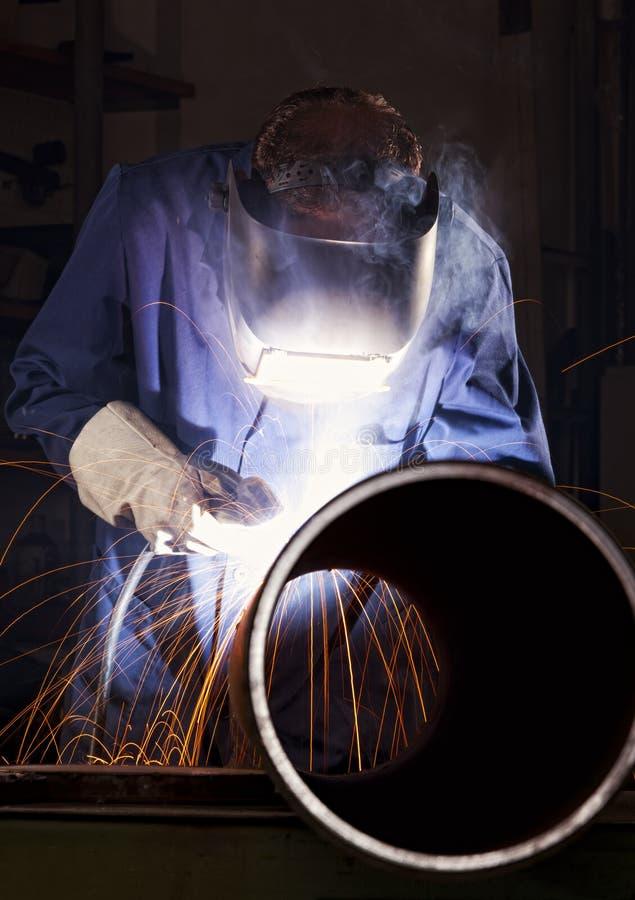 Worker Welding Pipe In Workshop. Stock Photos