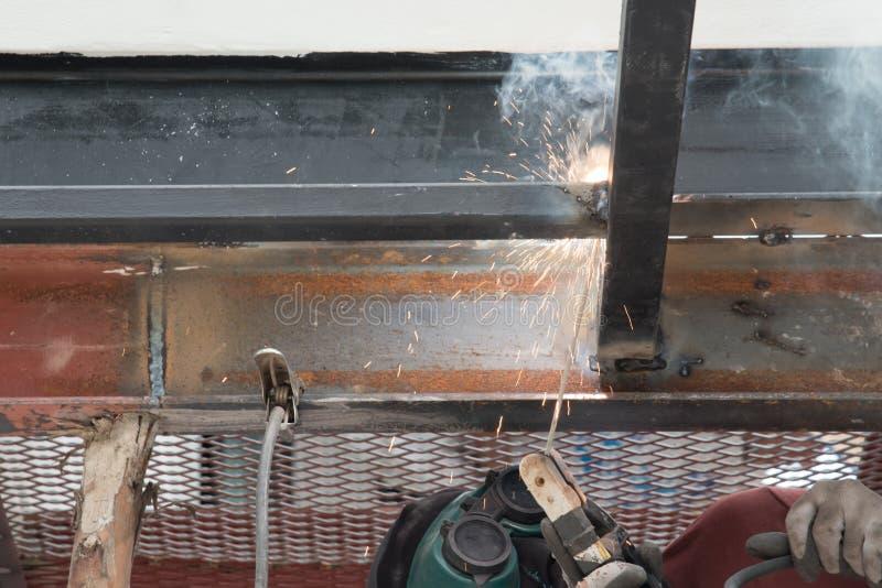 Worker welding the steel royalty free stock image