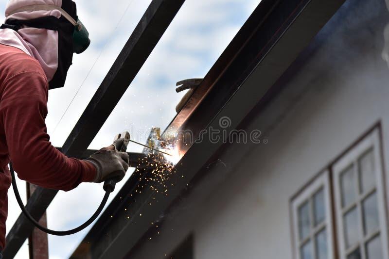 Worker welding the steel stock image