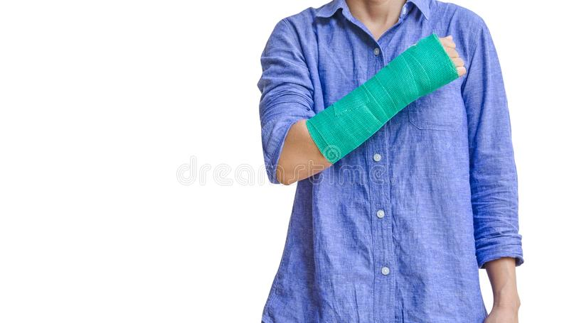 Worker woman accident on arm with green cast isolated on white.  royalty free stock images