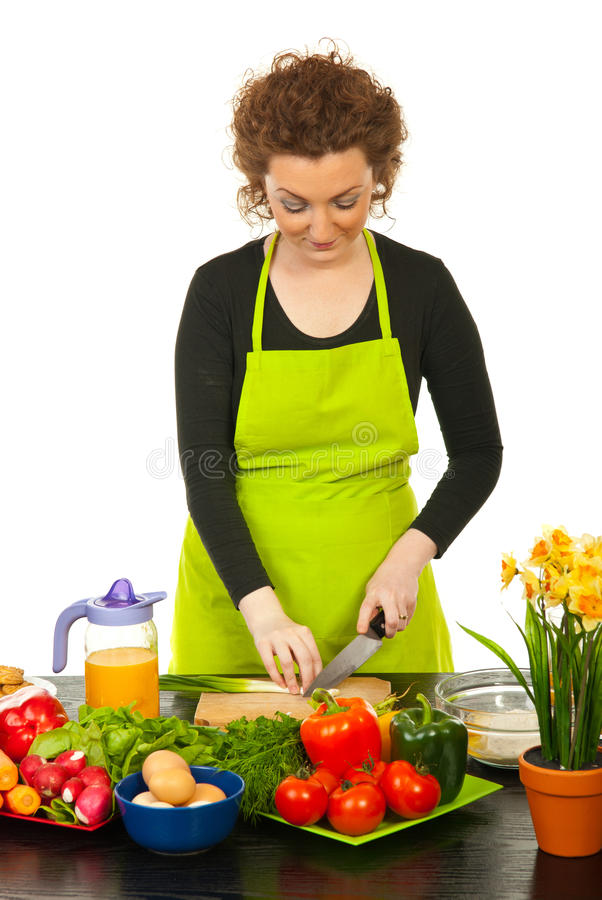 Worker woman cutting green onion royalty free stock images