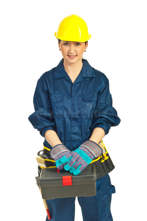 Worker woman holding tools container. Isolated on white background royalty free stock photo