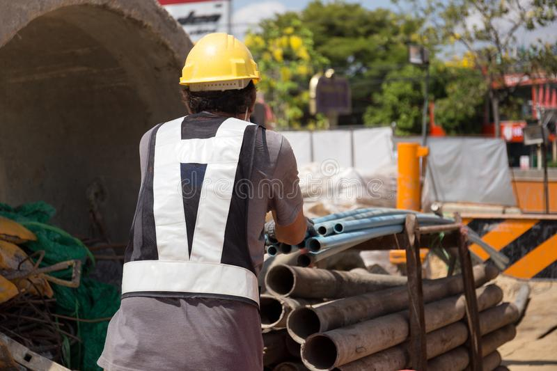 Worker working on PVC pipe line in construction site stock images