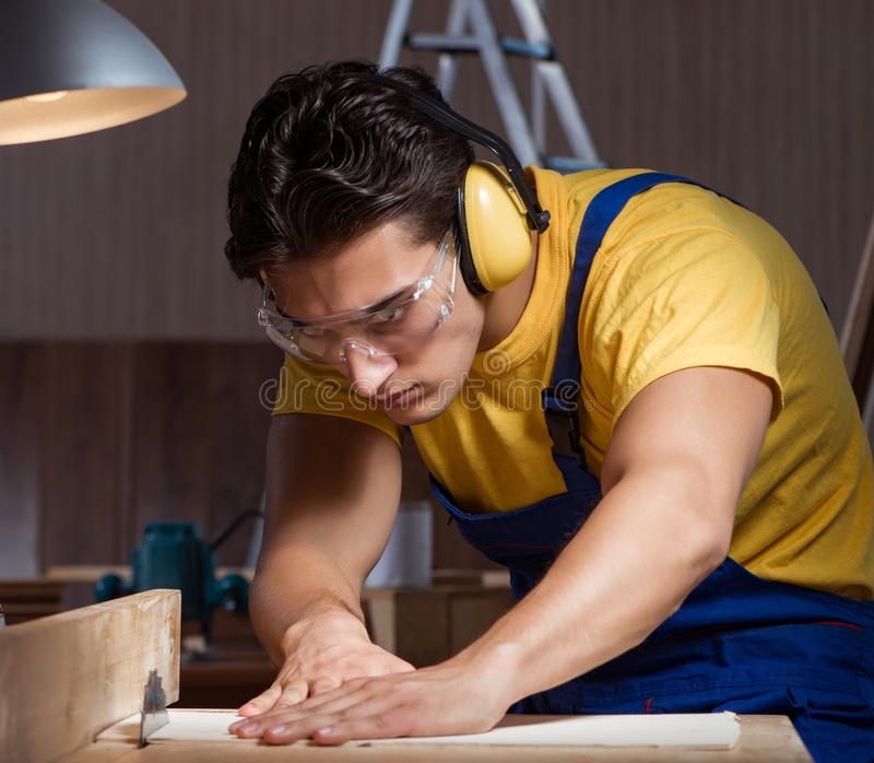The worker working in repair workshop in woodworking concept royalty free stock photography
