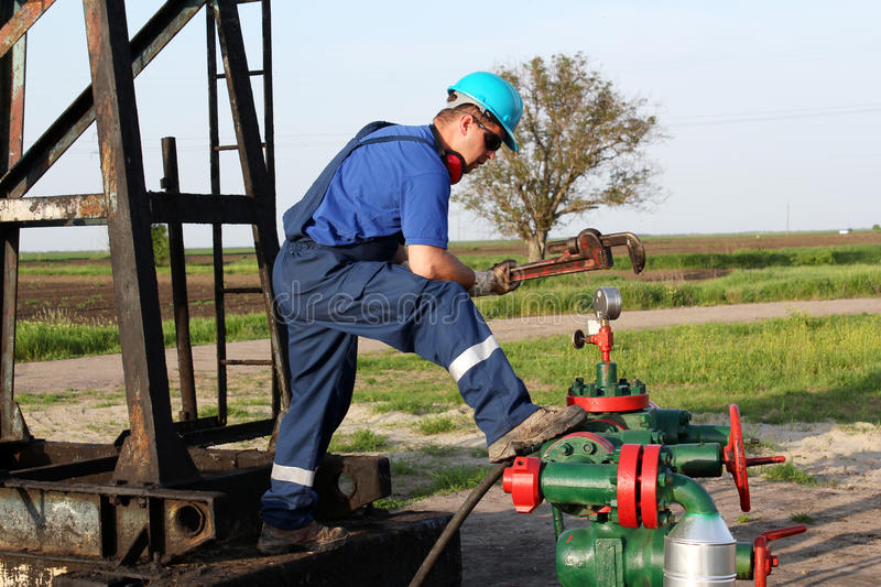 Worker with wrench check pipeline stock photography