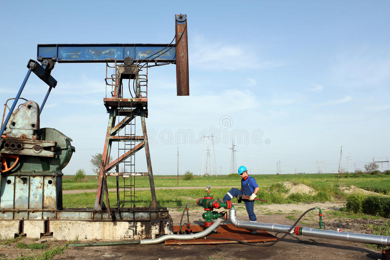Worker with wrench on oil field stock images