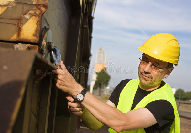 Worker in yellow hard hat royalty free stock photos