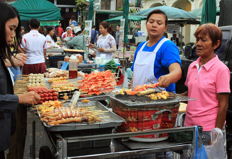 Workers of the abmulant food in Bangkok, Thailand royalty free stock photos