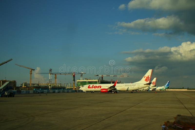 The workers at the airplane airport, Soekarno Hatta, which was photographed from behind the glass royalty free stock images