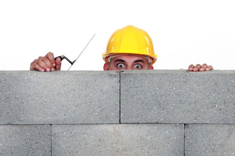 Download Workers behind wall stock image. Image of mason, high - 31132071