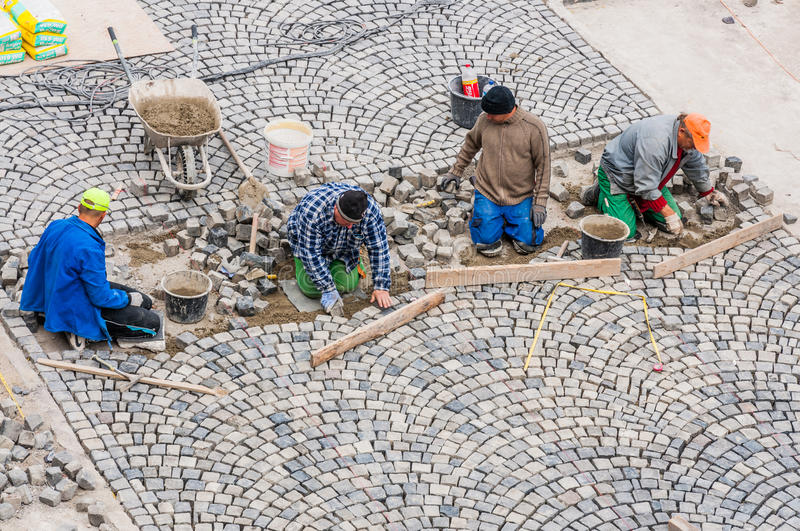 Workers building road paving in Buda Castle.