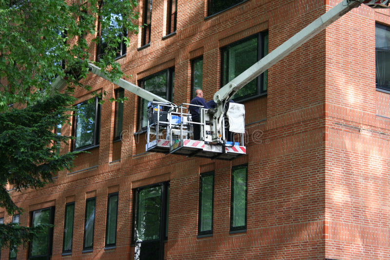 Workers in cherry picker stock photography