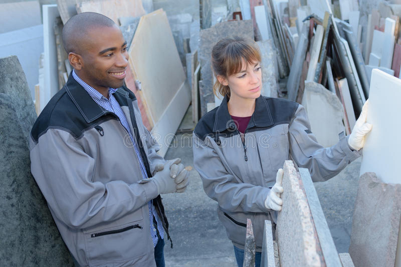 Workers choosing slabs stone stock photography
