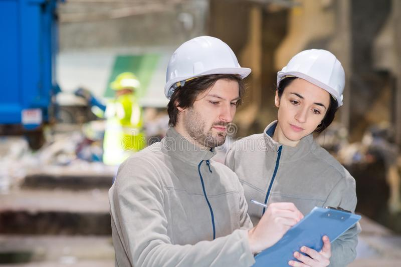 Workers with clipboard in recycling center royalty free stock photo