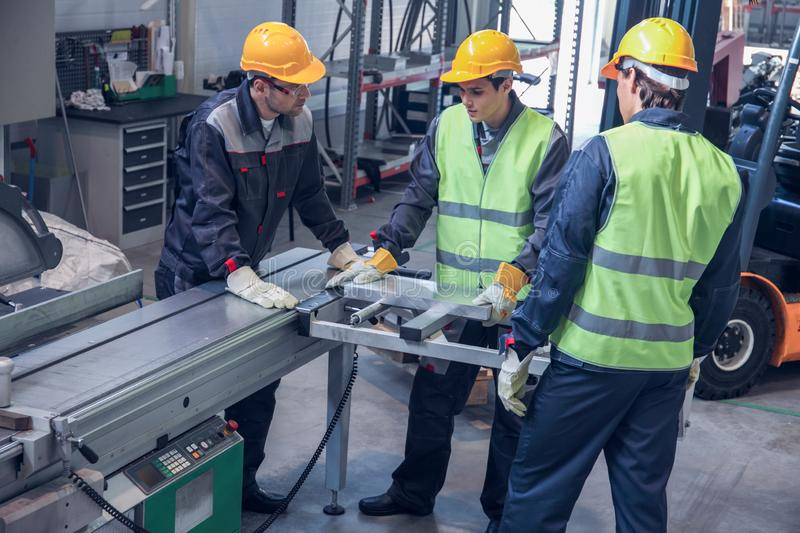 Workers at CNC machine shop stock images