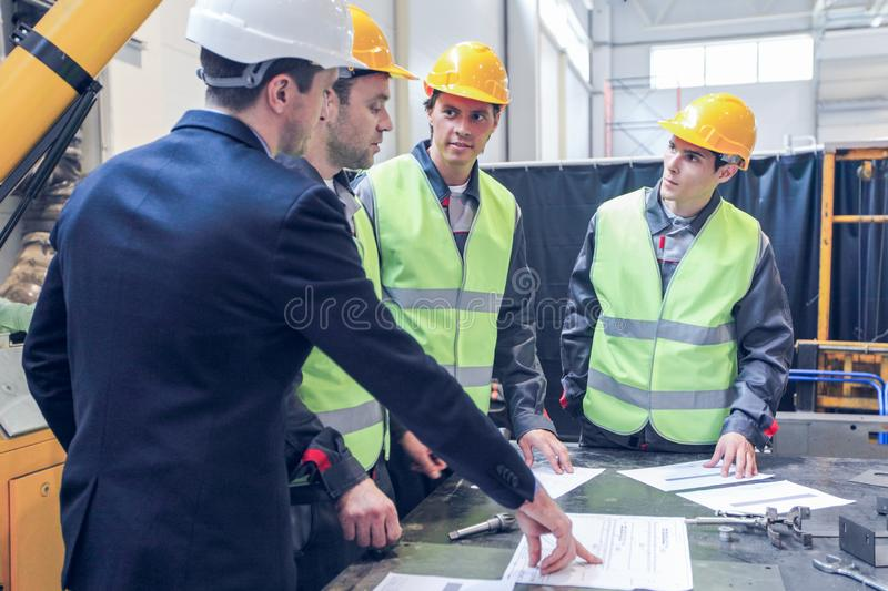 Workers at CNC machine shop royalty free stock images
