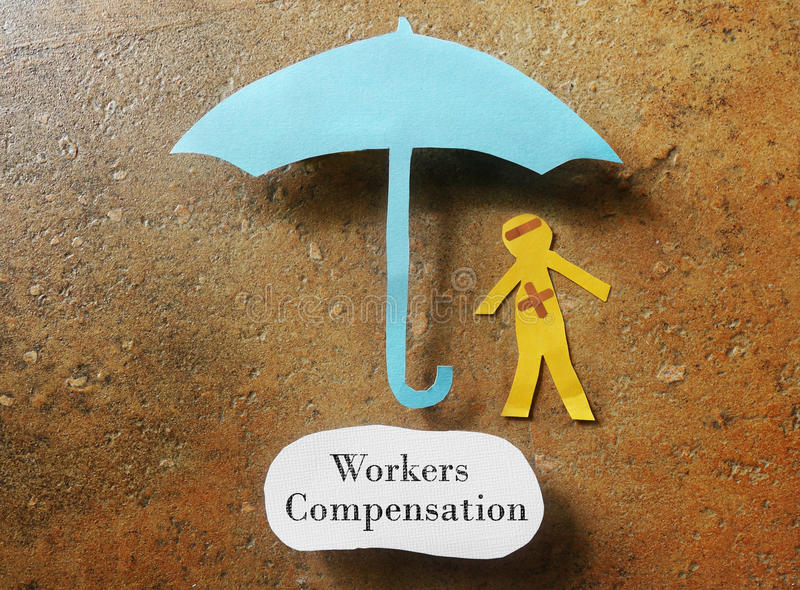 Workers Compensation concept. Bandaged paper man under umbrella with Workers Compensation note below royalty free stock photos
