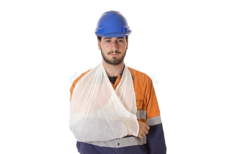 Workers Compensation Injury. A young man in work uniform wearing a sling facing forward looking into the camera stock photos