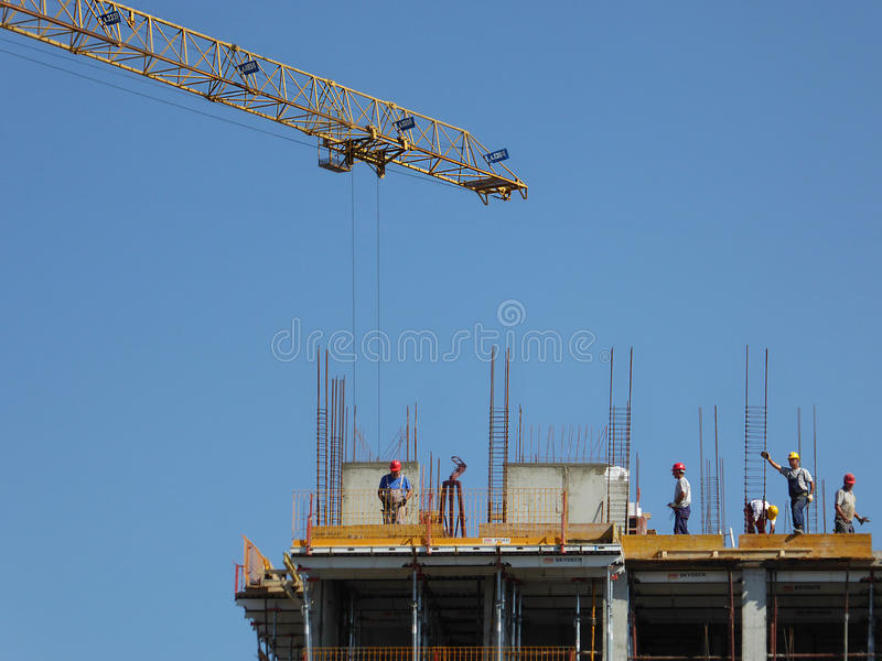 Workers on the construction. With crane royalty free stock photo
