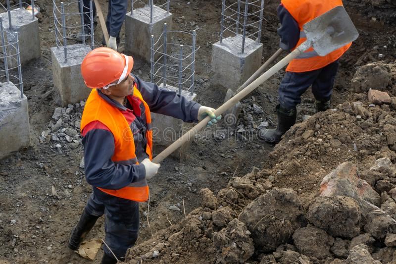 Workers at the construction site clearing debris stock image