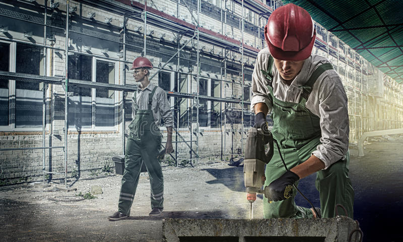 Workers at a construction site. Workers at the construction site drilled concrete royalty free stock image