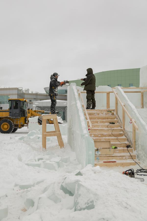 Two workers at the site of the ice camp stock image