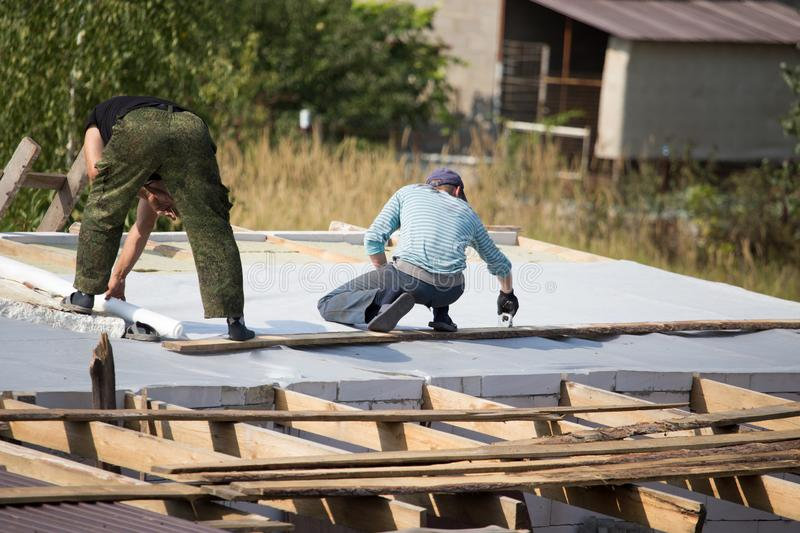 Workers cut the roof in the house.  royalty free stock photography
