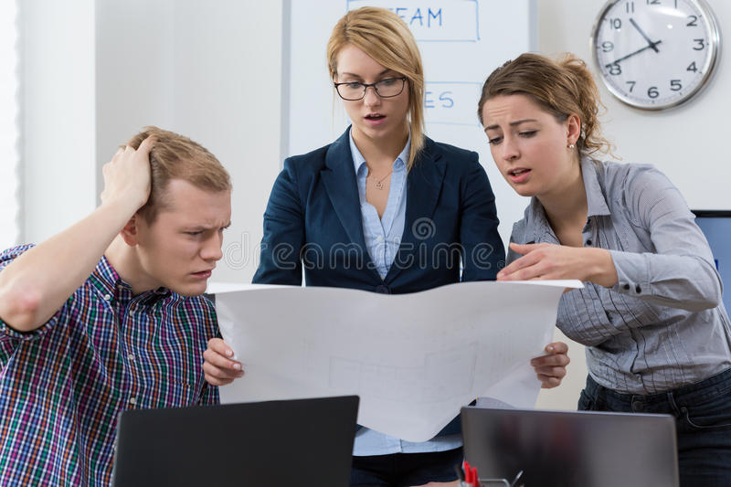 Workers discuss the project stock images