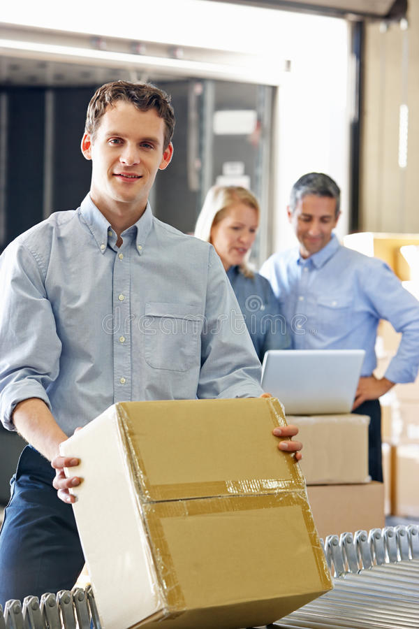 Workers In Distribution Warehouse royalty free stock image