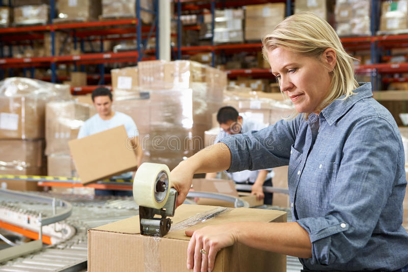 Workers In Distribution Warehouse stock images