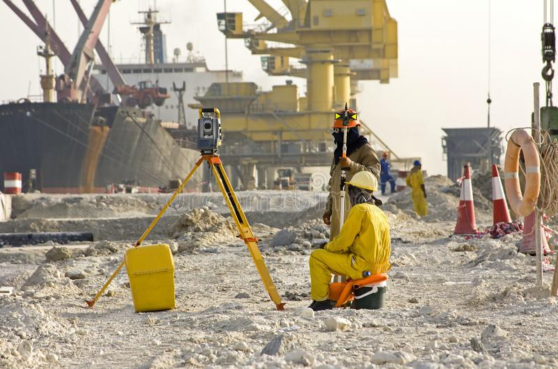 Workers doing measurement at the construction site. stock photography