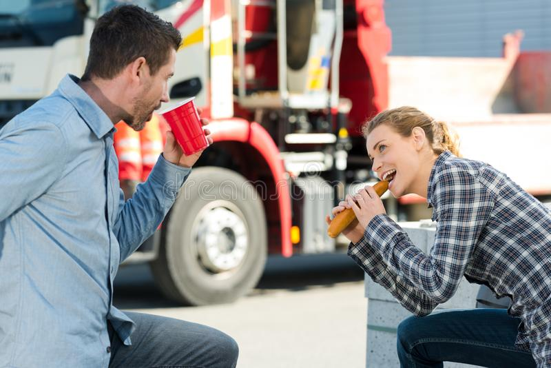 Workers eating lunch outdoors stock images