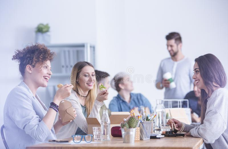 Workers eating at the office royalty free stock photos