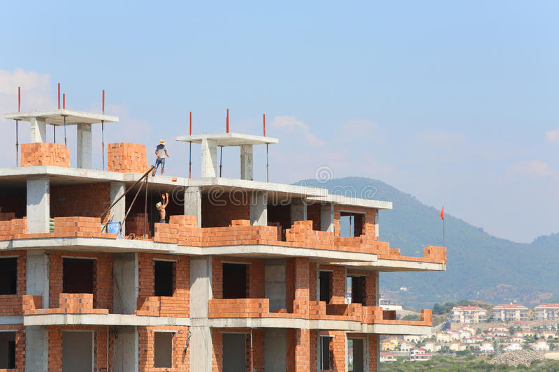 Download Workers Erect Balconies From Brick In New Building Stock Image - Image: 31682187