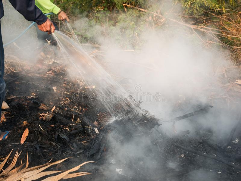Workers Extinguish Fire with Water royalty free stock image