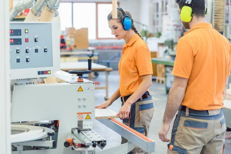 Workers in Furniture Factory in the production process stock image